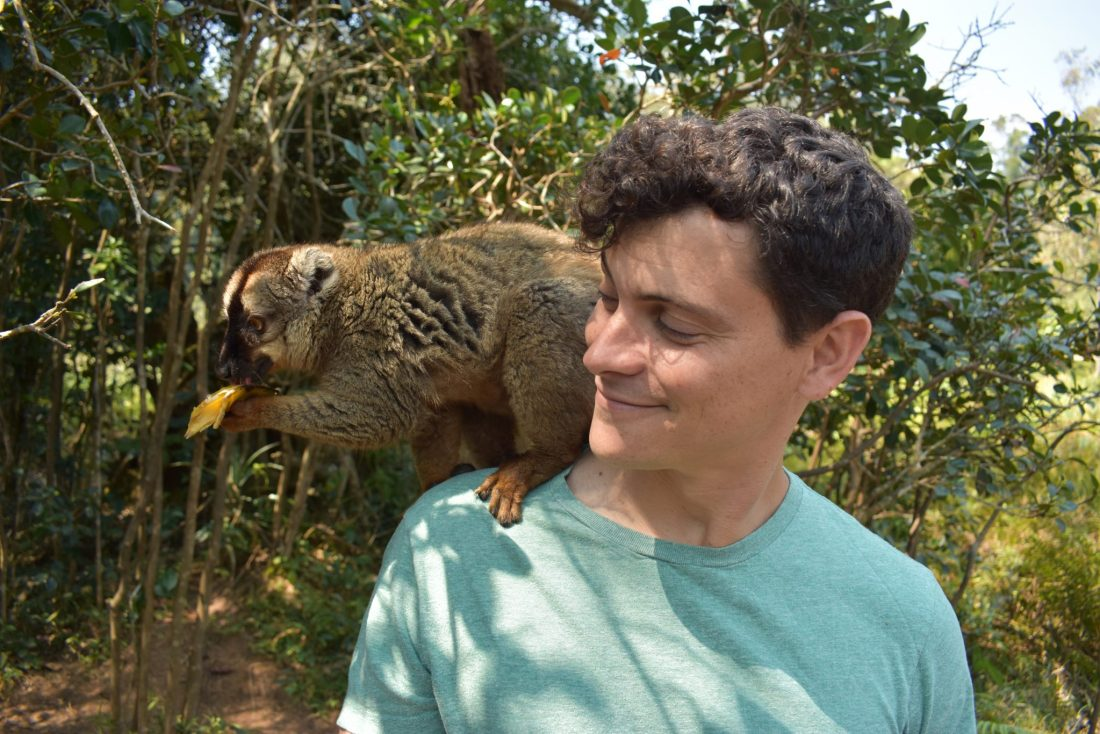Travel blogger Nomadic Matt has many travel anxiety tips. He is seen here with a monkey on his shoulder.