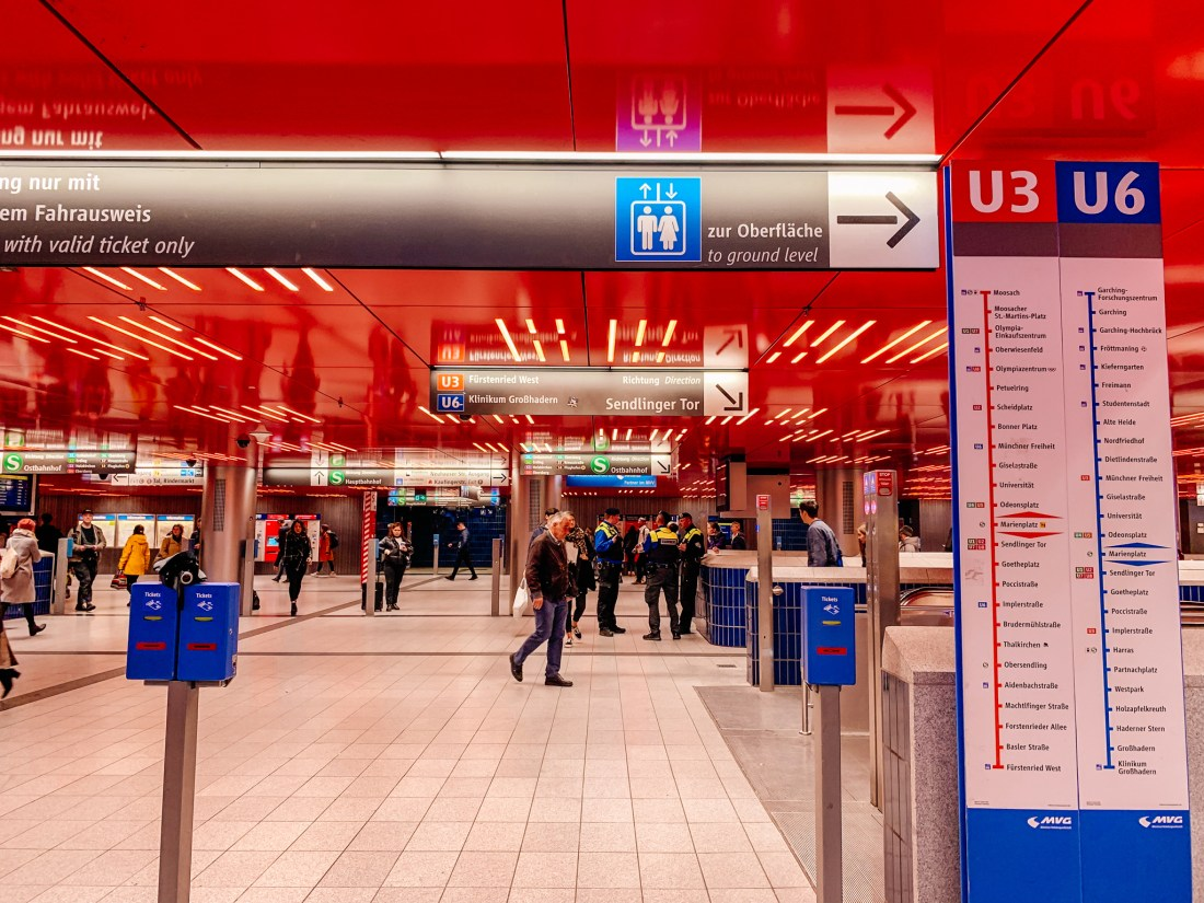 The platform of the subway station at Marienplatz in Munich, with a red ceiling. This is one of the hubs of Munich public transport.