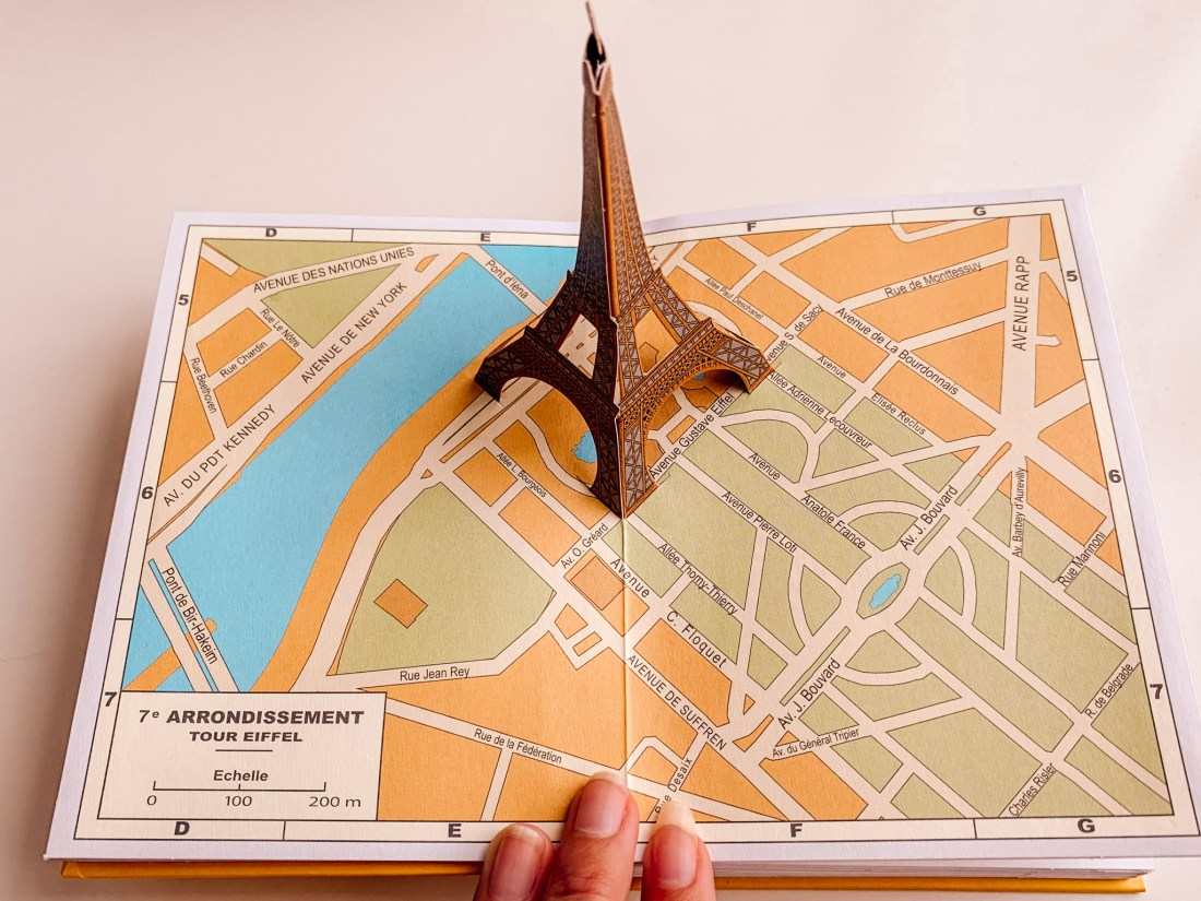 A copy of Paris Pop-Up, with a popped up Eiffel Tower. This book is a great gift and memento.
