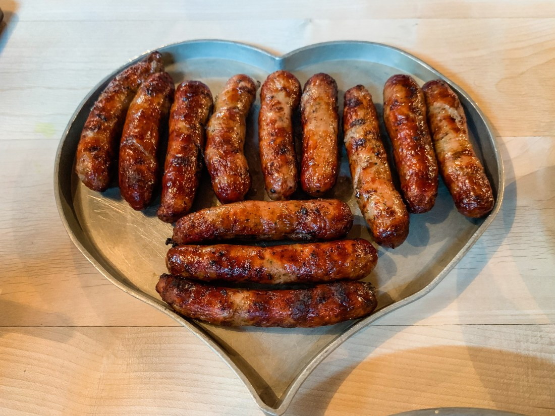 A heart-shaped platter of Nuremberg sausages. These are a region-specific traditional German food.