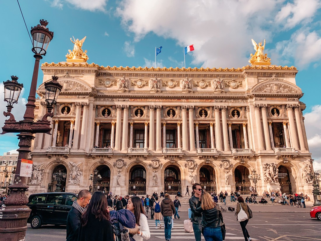 The Palais Garnier is one of the city's most loved Paris landmarks. Two golden statues sit on the roof.