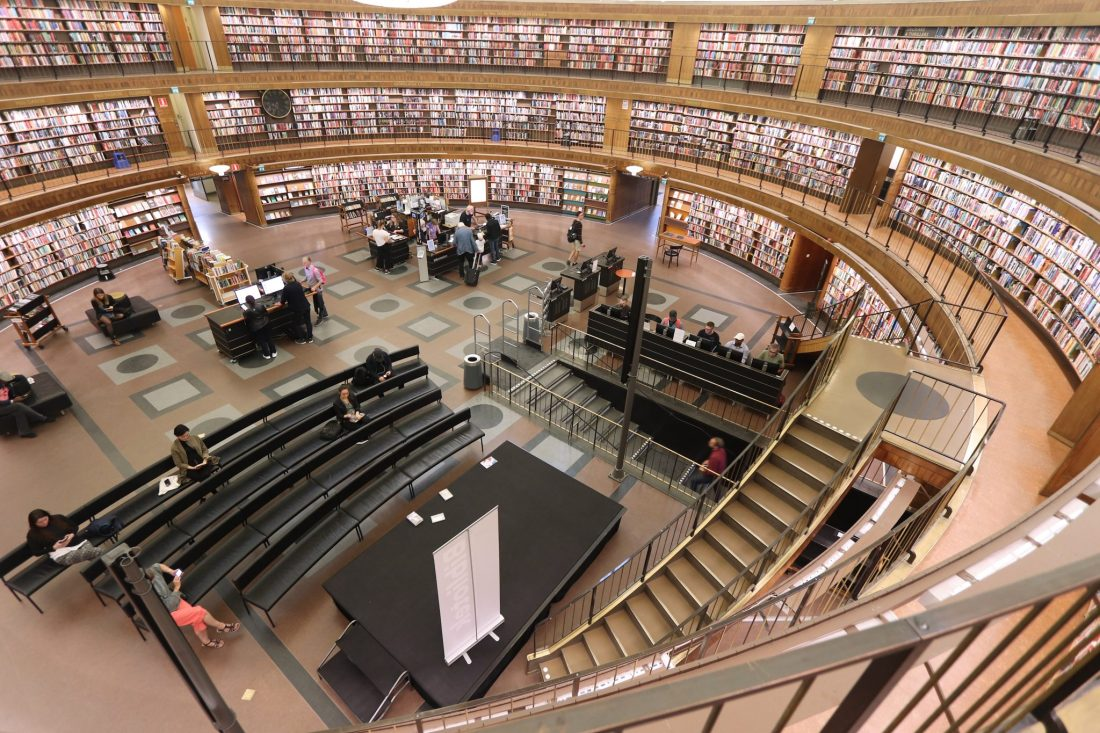 The curved interior of Stockholm Public Library, with bookshelves on all sides