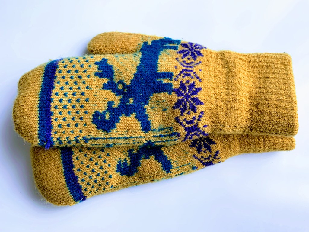 A pair of yellow and blue mittens, a popular Stockholm souvenir.