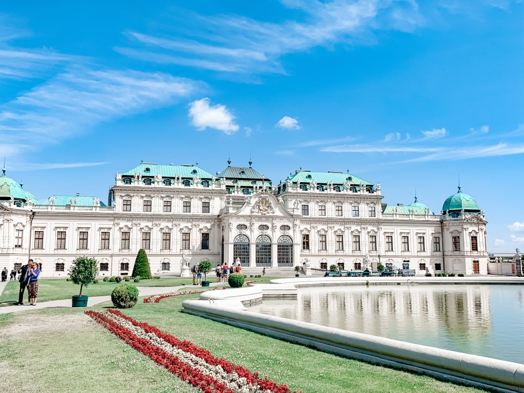 The Belvedere Art Gallery inVienna stands next to an ornamental lake. Going from Budapest to Vienna is an easy trip.