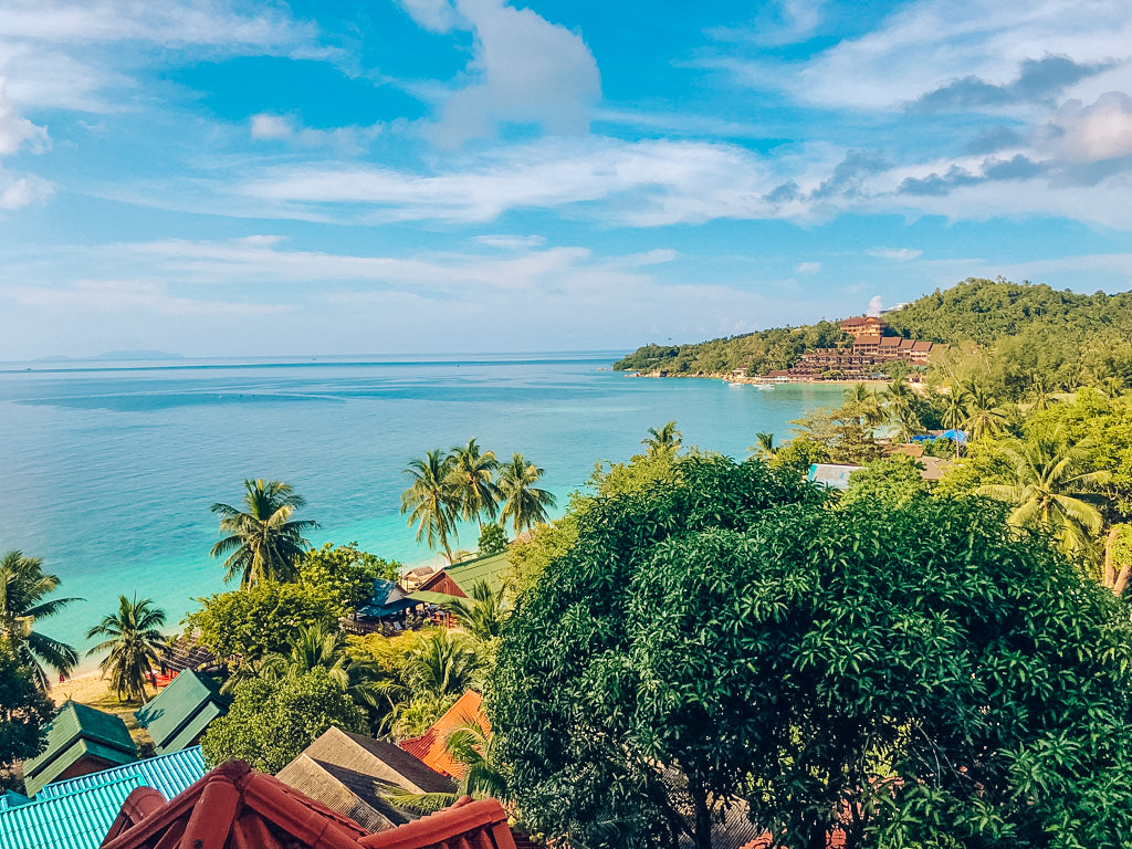 Blue sea and palm trees on a beach in Koh Phangan, Thailand