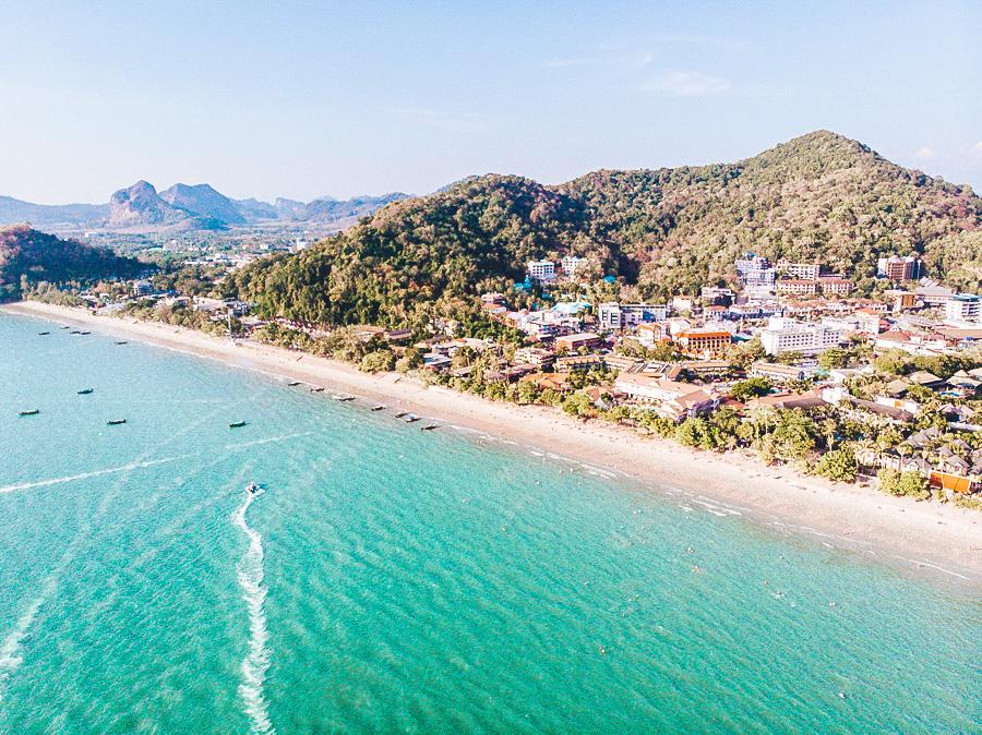 Blue sea lapping against a long beach in Krabi, Thailand