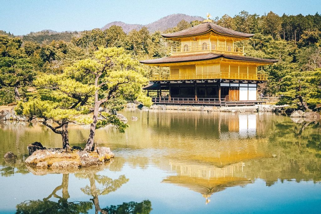 A beautiful building by a lake in Japan