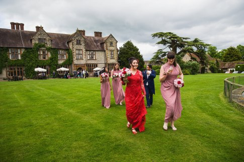 Bridal party with the country house in the background -D&H wedding - real wedding inspiration