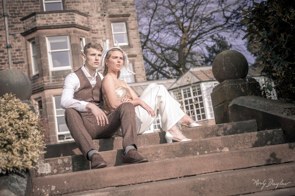 Game of thrones wedding - couple sat on steps with bespoke millinery
