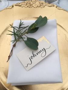 bespoke calligraphy wedding place names with gold leaf