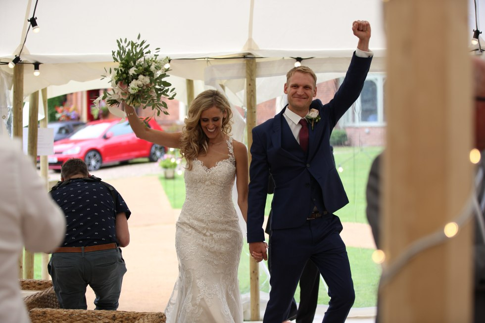 real marquee wedding inspiration - bride and groom - oversized bouquet - greenery