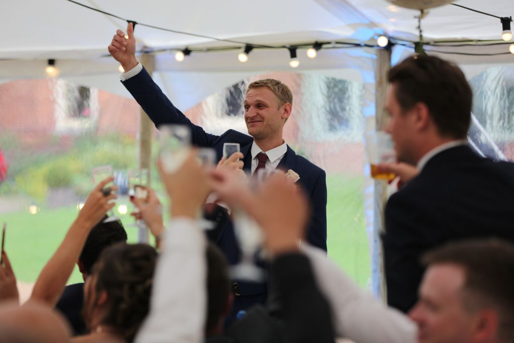 Real marquee wedding inspiration - speeches - groom - cheers