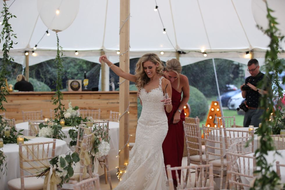 real marquee wedding inspiration - festoon lights - balloons - greenery - gold