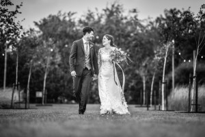 B&A wedding day - Oaktree farm outdoor wedding venue in nottinghamshire / lincolnshire - couple shot walking outside the wedding venue between the trees