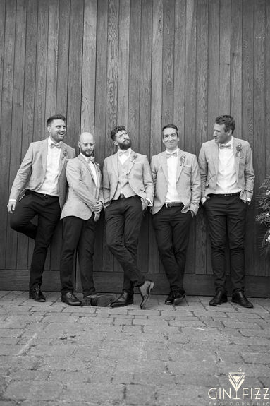 B&N barn wedding at castle view farm & stables - grooms party photo in front of the barn doors 2
