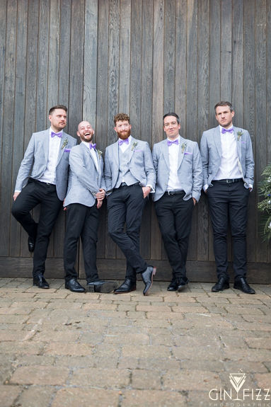 B&N barn wedding at castle view farm & stables - grooms party photo in front of the barn doors