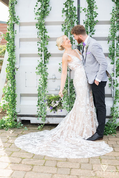 B&N wedding at castle view farm - couple shot in front of shipping container