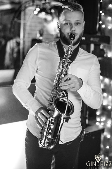 B&N wedding day castle view farm & stables wedding venue - wedding entertainment saxophonist in action