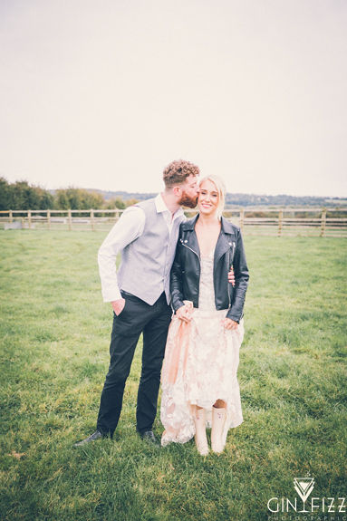 B&N outdoor wedding day castle view farm and stables leicestershire wedding venue - bride and groom kissing