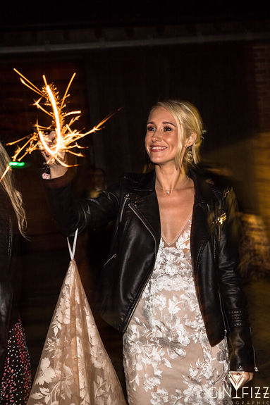 B&N barn wedding day at castle view farm & stables- bride with sparklers and leather jacket