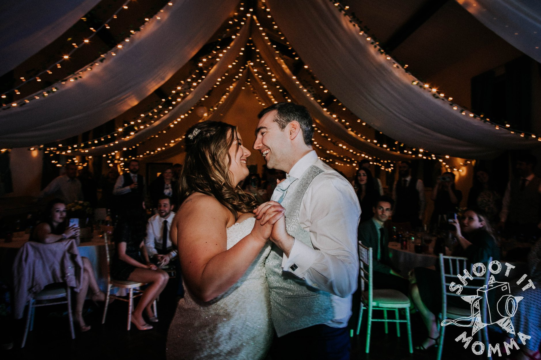 M&W village hall wedding day as captured by Shoot it Momma photography - first dance captured smiling