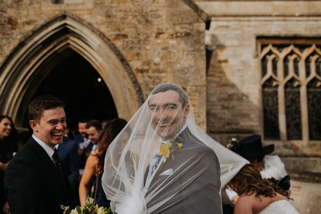funny wedding photo - groom with veil on his head - rutland wedding - fun wedding - east midlands wedding planner - Leicestershire wedding planning - nottingham wedding planning - that black and white cat - unique wedding planner