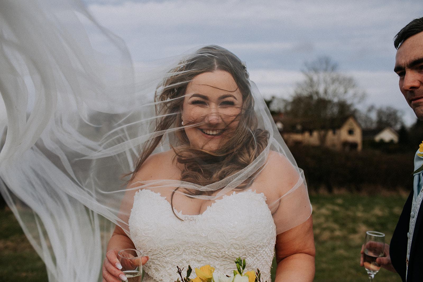 bride with veil blowing in the wind - rutland wedding - fun wedding - east midlands wedding planner - Leicestershire wedding planning - nottingham wedding planning