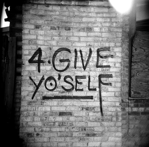 forgive yourself written on brick wall