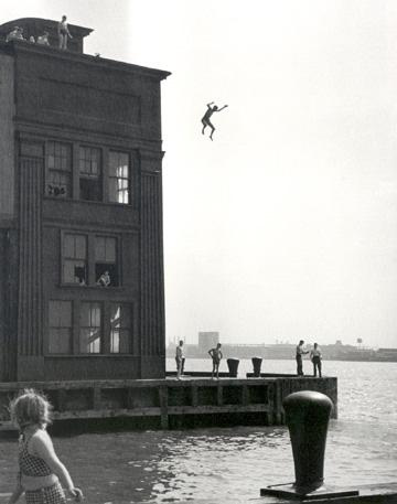 man jumping from building into the bay
