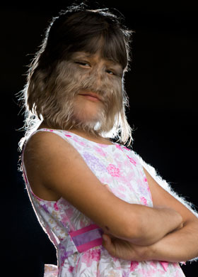 wof child with hair on face