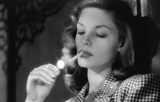 lauren bacall lighting a cigarette