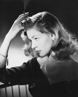 lauren bacall black and white photo with cigarette