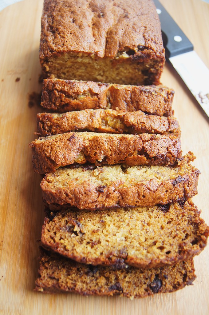 Chrissy-Teigen-Famous-Banana-Bread-overhead-clices-on-cutting-board-with-knife