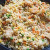 One-Pot-Shrimp-Fried-Rice-in-skillet-with-wooden-spoon-2