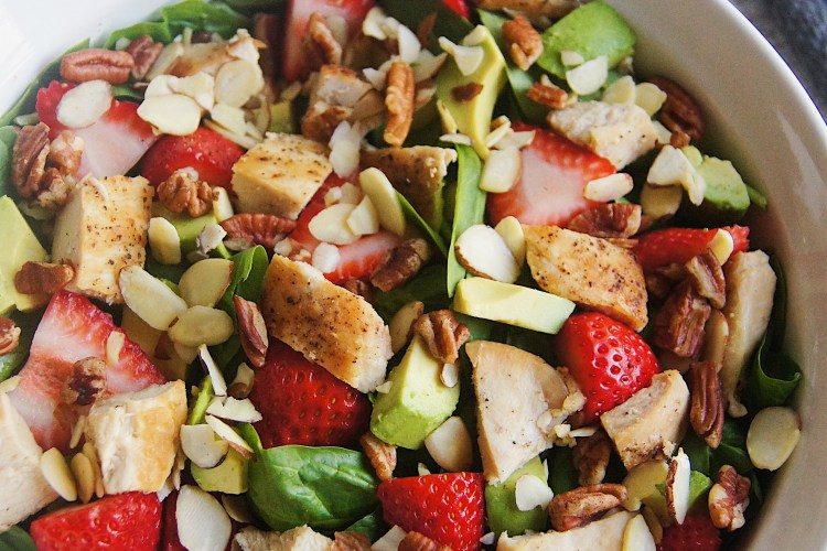 Strawberry-Spinach-Salad-overhead-with-olive-oil-and-vinegar