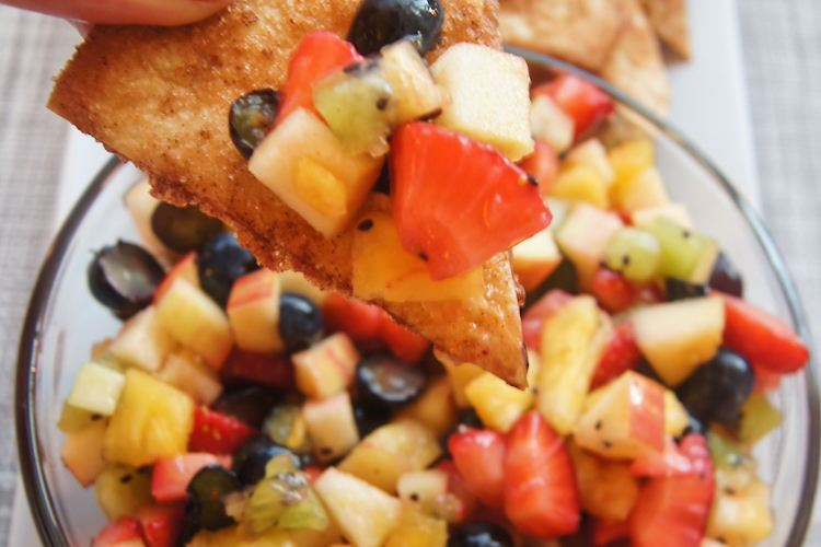 Fruit Salsa and Cinnamon Chips with hand holding chip and fruit