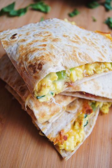 Simple Breakfast Quesadillas stacked on a cutting board
