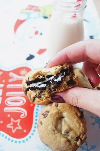 Chocolate chip oreo cookies hand holding bitten cookie