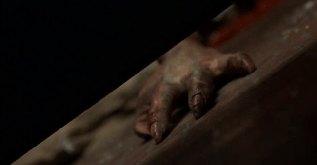 What The Alien In The Pantry Means In M Night Shyamalan S Signs That Moment In