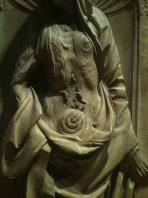 worms and entrails fall from stomach of Comtesse d'Auvergne sculpture.