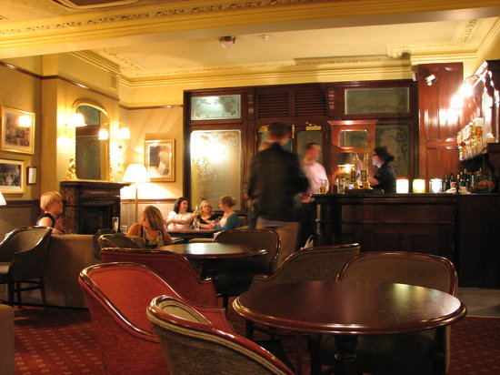 patrons at the bar of the Princess Louise pub
