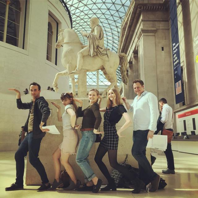 treasure hunters posing as egyptians in front of roman equestrian statue in the British Museum's great court
