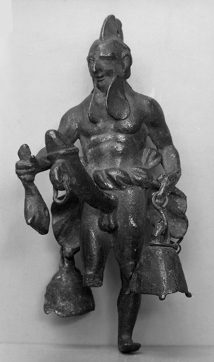 Metal figure with a large erect phallus with bells hanging off. A tintinnabulum depicting Priapus from the British Museum