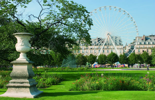 sculpture and flowers in Jardin des Tuileries Paris with ferris wheel in the background
