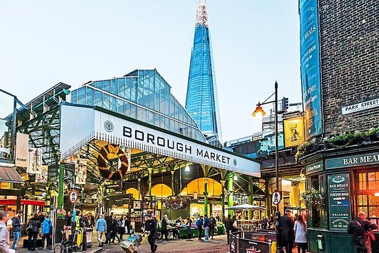 Entrance to Borough Market on Park street by classic pub and view of The Shard