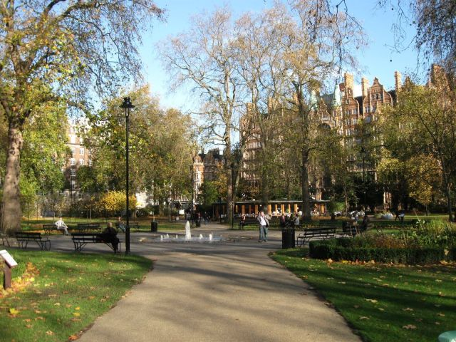 Path, benches, fountain and cafe in Russell Square London