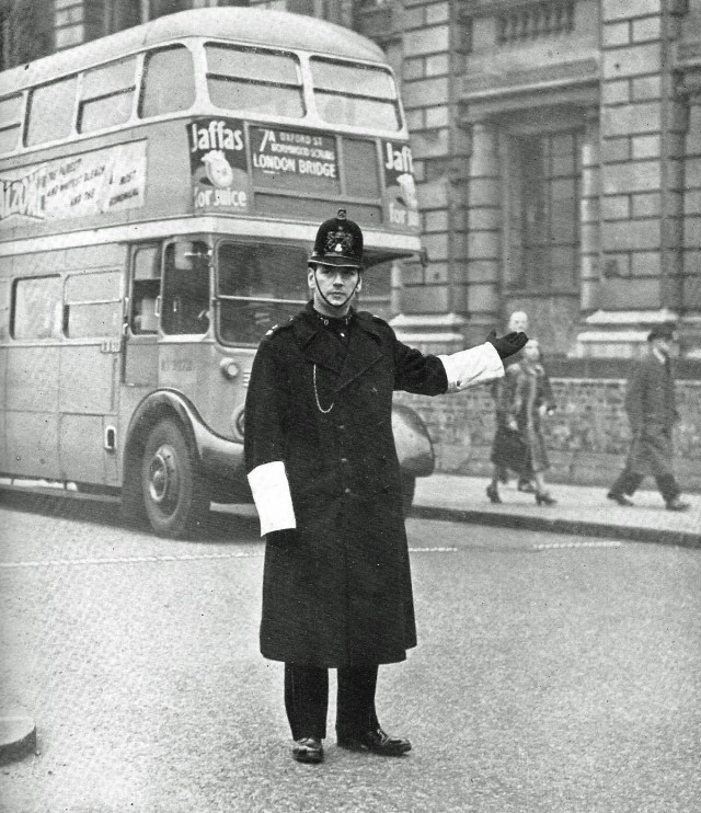 A police officer conducting traffic