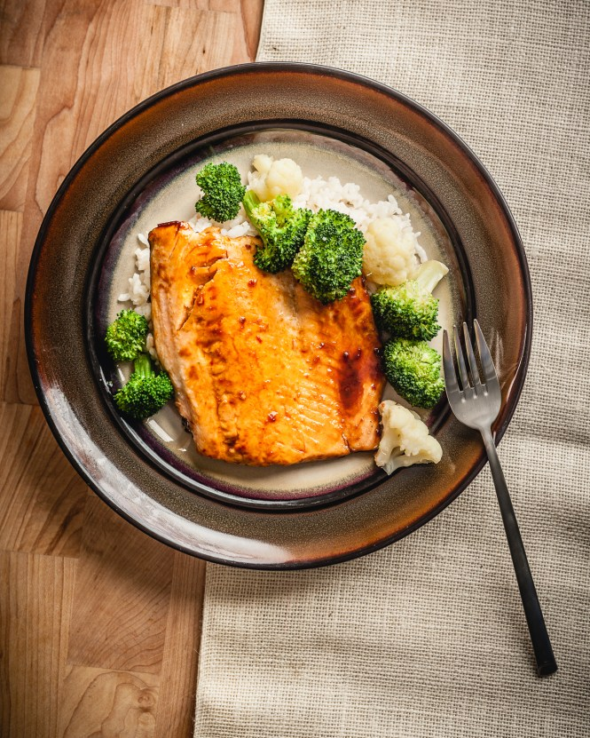 sous vide salmon with steamed rice and broccoli