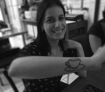 Coffee tattoo on arm of customer