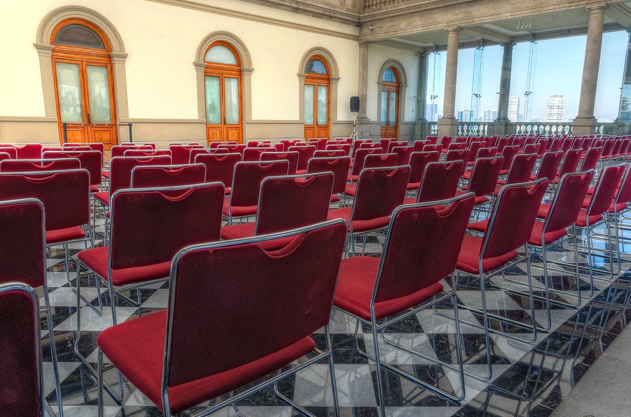 Meeting room, stone arches, red chairs